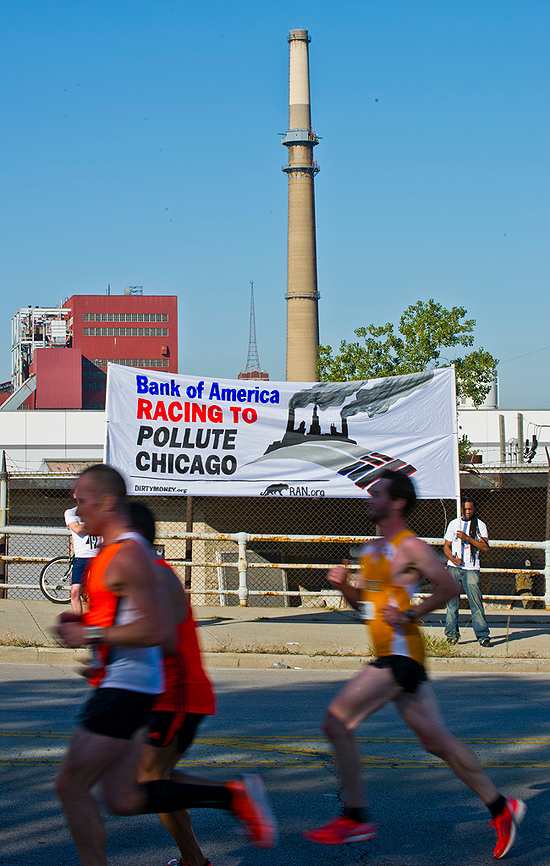 RAN activists hold up banner outside Fisk coal-fired power plant during Chicago Marathon