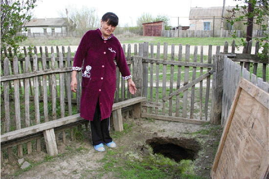Sinkhole in yard of Saniya Nurzhanova, the village Berezovka, April 2012.