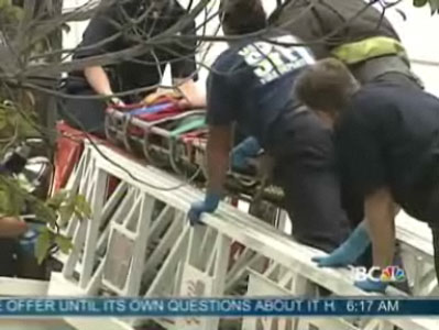 Firefighters take injured woman down a ladder