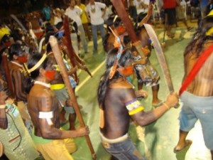 Kayapo men enter gymnasium at opening ceremony