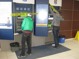Marking the ATM early in the morning before the bank opens.