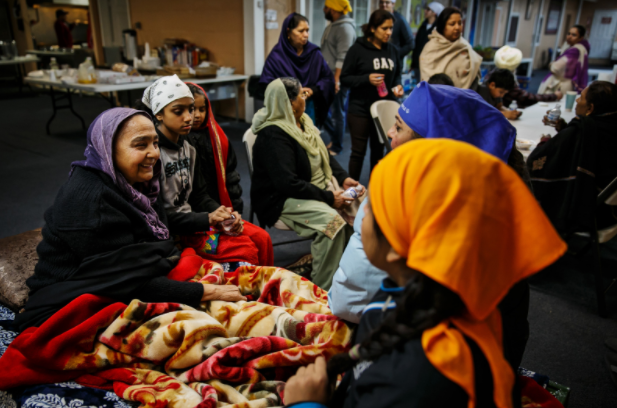 Evacuees and Sikhs chat at Shri Guru Ravidass temple in Rio Linda, Calif., north of Sacramento. (Marcus Yam / Los Angeles Times)