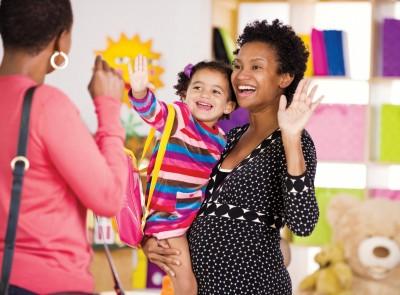 teacher-holding-kid-smiling-mother_400x295_71.jpg