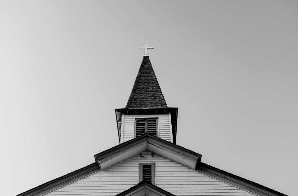 Black and white photo of a church steeple
