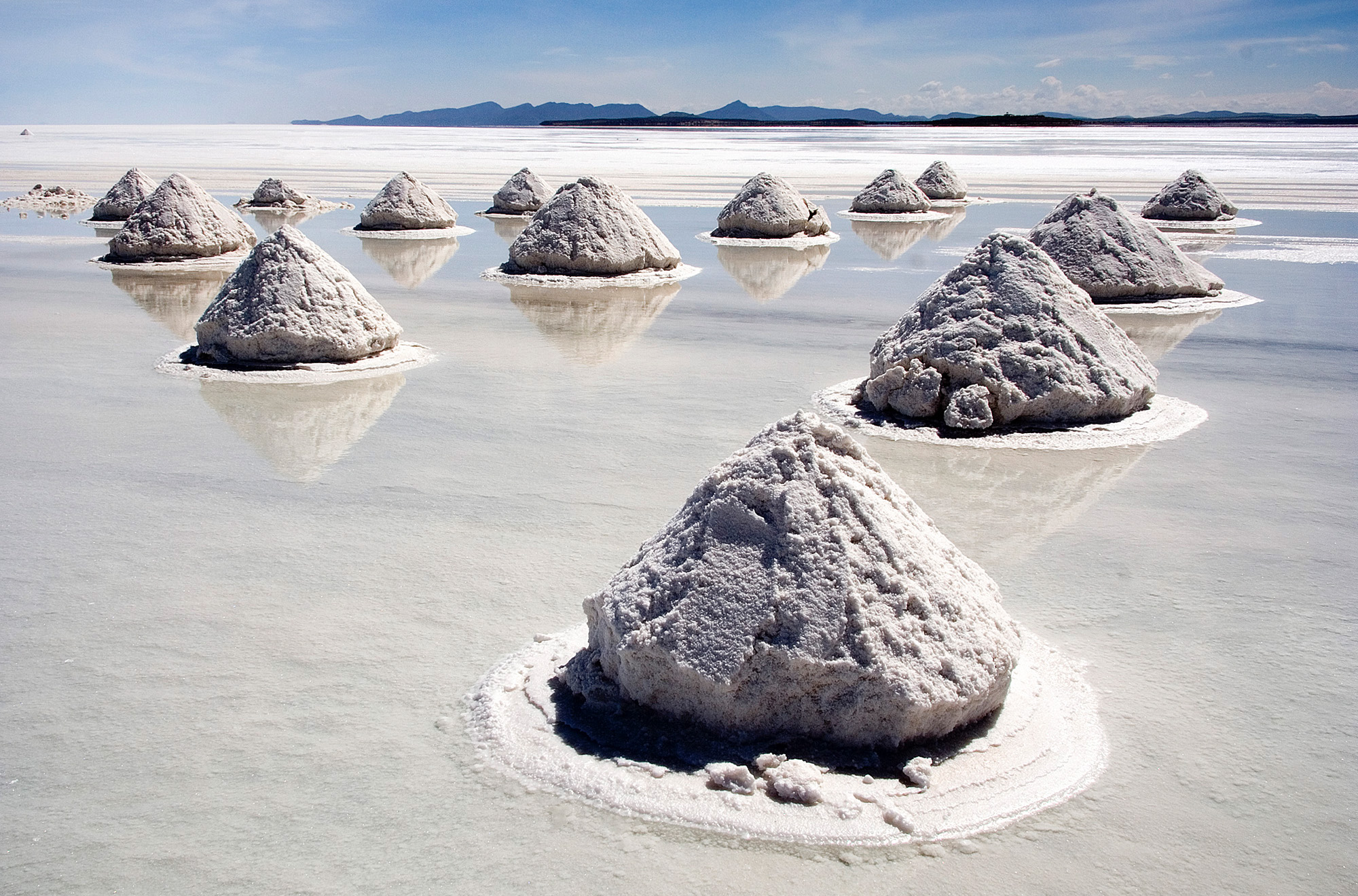 https://d3n8a8pro7vhmx.cloudfront.net/religioussocialism/pages/187/attachments/original/1573753793/Piles_of_Salt_Salar_de_Uyuni_Bolivia_Luca_Galuzzi_2006_a.jpg?1573753793