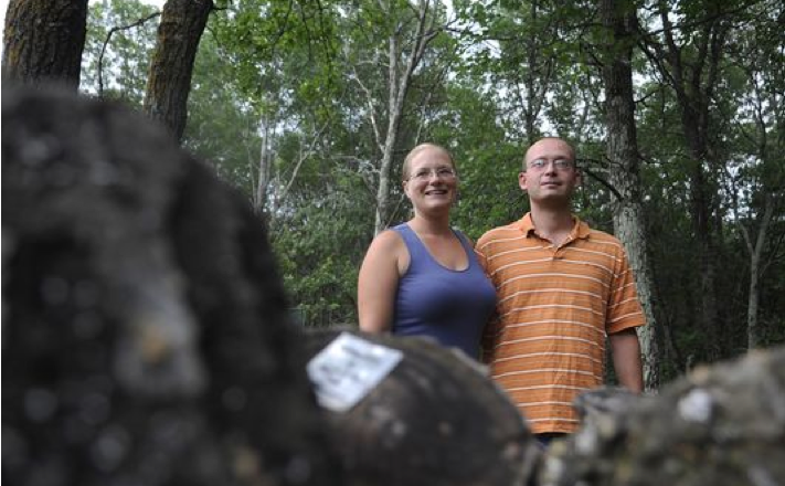 Christy_Paulson_and_Matt_Ratliff_with_mushroom_logs._(Photo-_William_Camargo__St._Cloud_Times.png