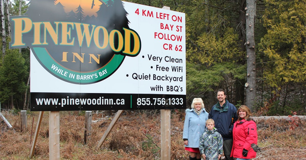 MP Cheryl Gallant with Pinewood Inn's new highway signs