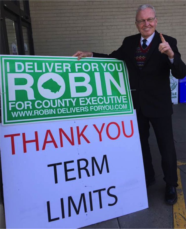 Robin_with_campaign_and_term_limits_signs.png