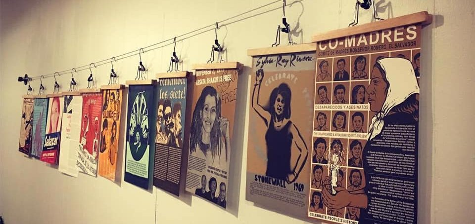 A series of posters depicting powerful women and femmes stretches toward the future.