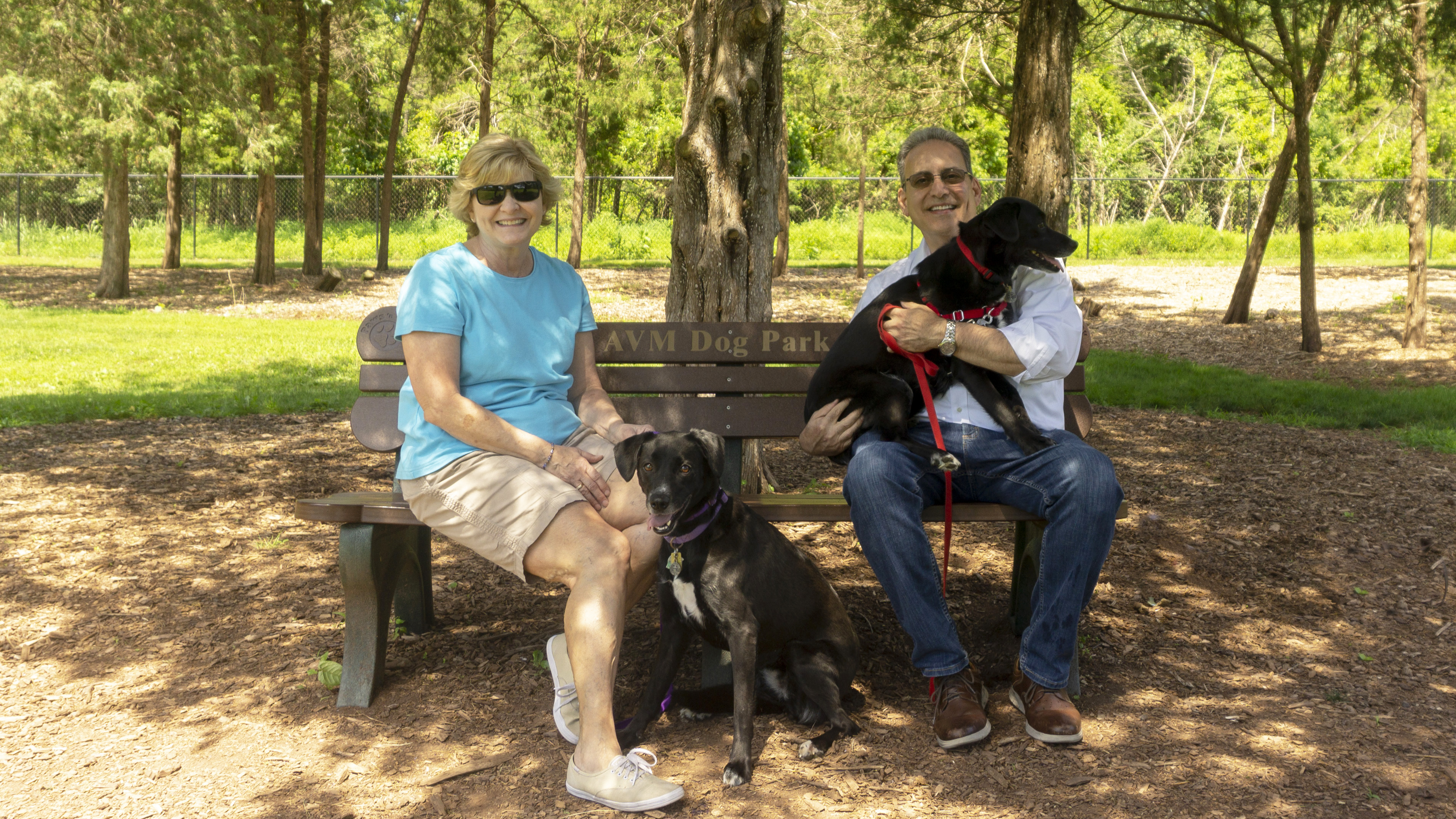 Assemblyman Roy Freiman and his wife Vicki sitting on a park bench in Ann Van Middlesworth Dog Park in Hillsborough, New Jersey.