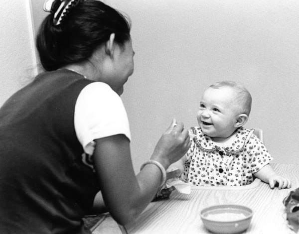 woman-feeding-blond-baby.jpg