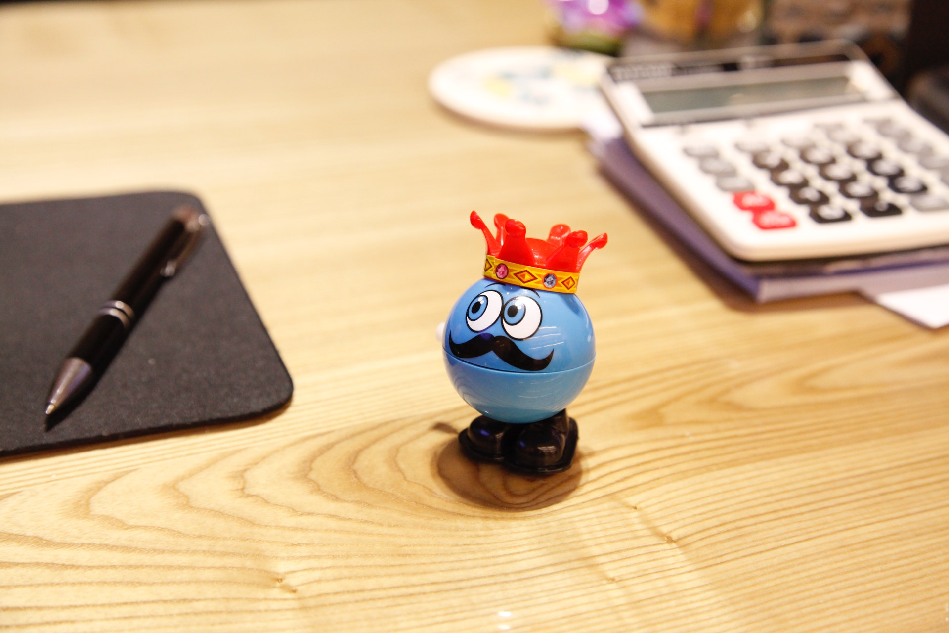 blue-round-plastic-toy-on-a-desk-234171.jpg