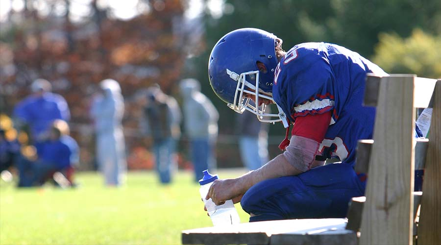 Football player on bench