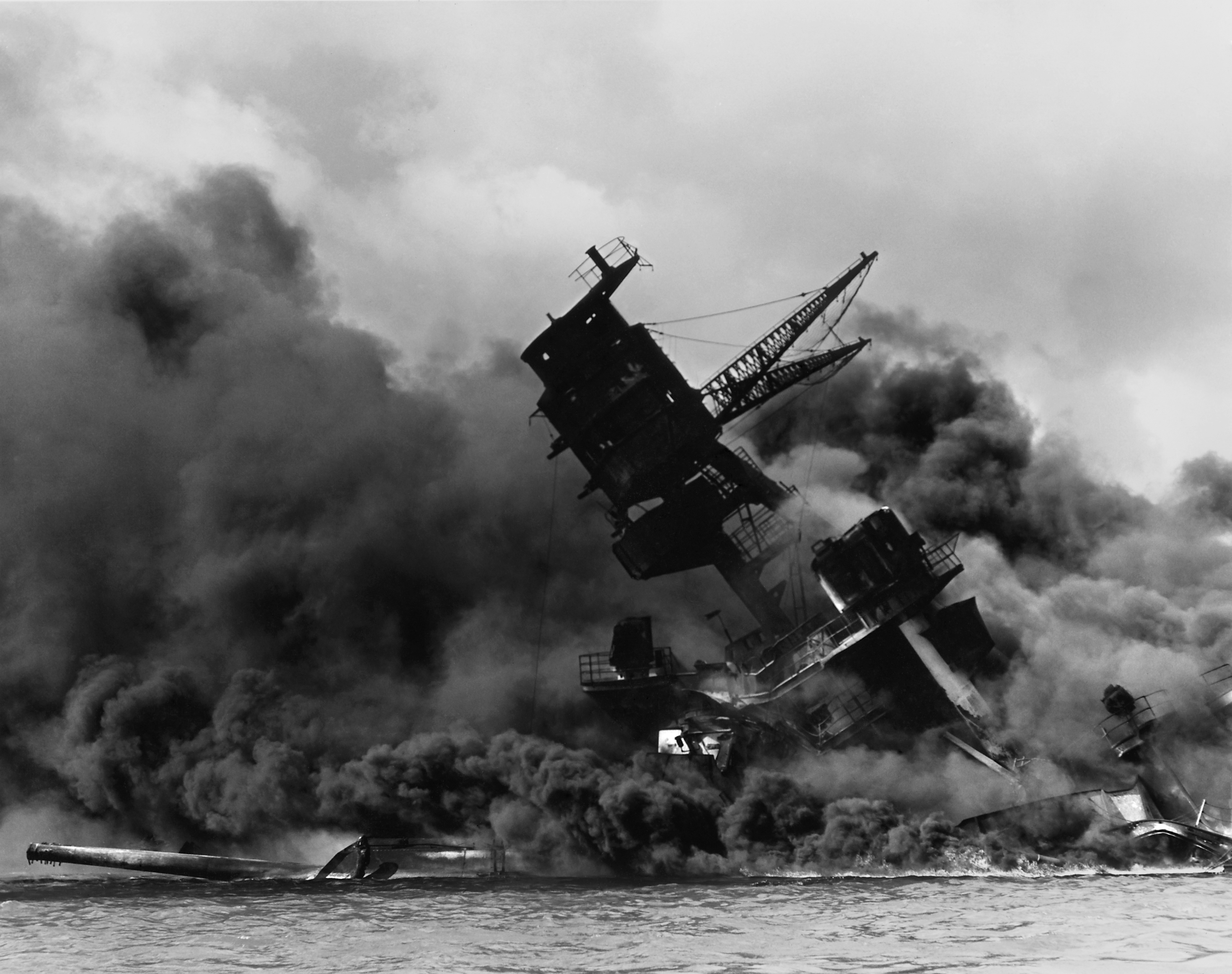 The_USS_Arizona_(BB-39)_burning_after_the_Japanese_attack_on_Pearl_Harbor_-_NARA_195617_-_Edit.jpg