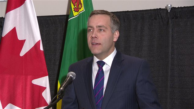 Broten_at_press_conference.jpg