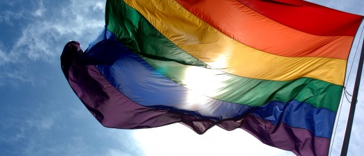 Rainbow_flag_and_blue_skies-525x225.jpg