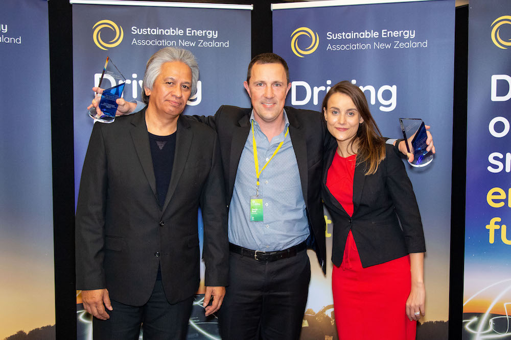 Best solar grid-connected and best solar and storage grid-connected; David Reid from Reid Technology with with SEANZ Chair Brendan Winitana and Keisha Noronho from sponsor, Fronius Inverters