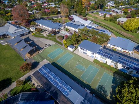 An arial photo of Otonga School showing several buildings with solar panels on the roof.