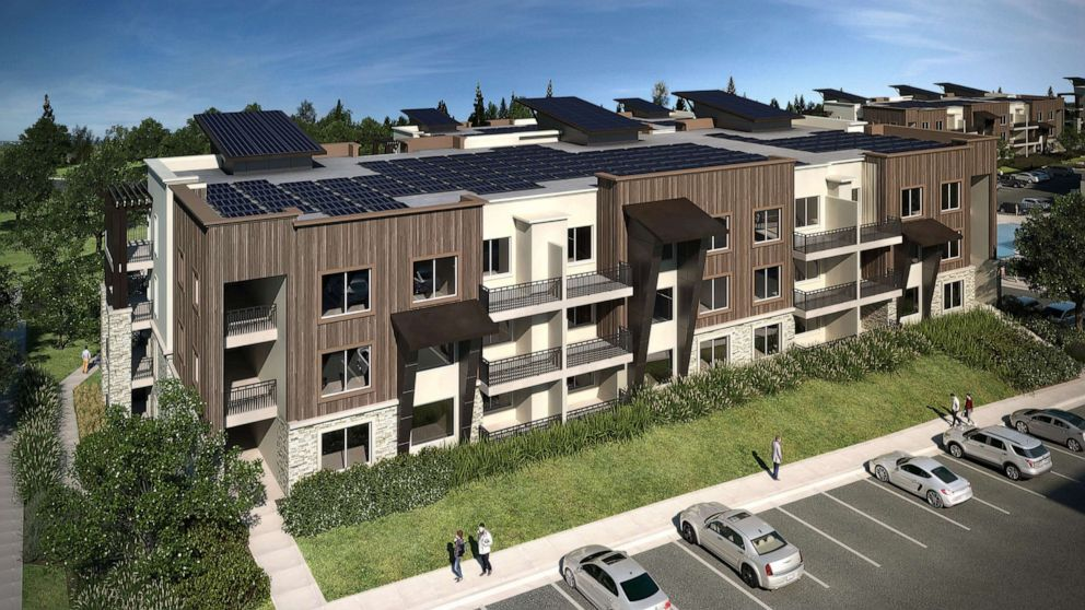 apartment buildings with solar panels on the roog