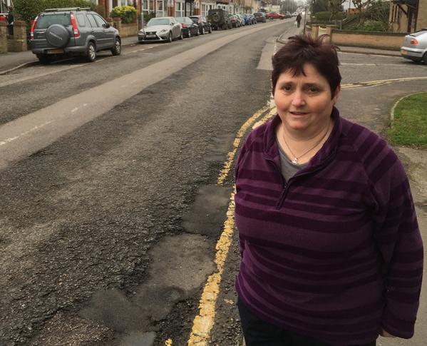 Councillor Christine Whelan with Potholes