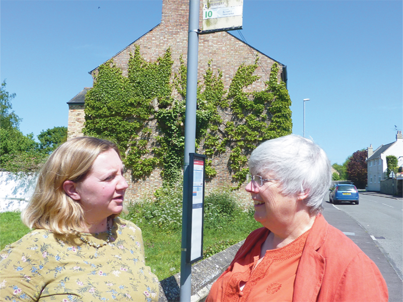 CHarlotte Cane and Lucy Nethsingha talking about lack of public services at bus stop
