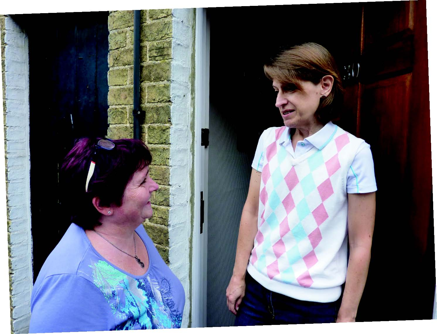 Christine Whelan and Paola Trimarco discussing parking on St Johns Road
