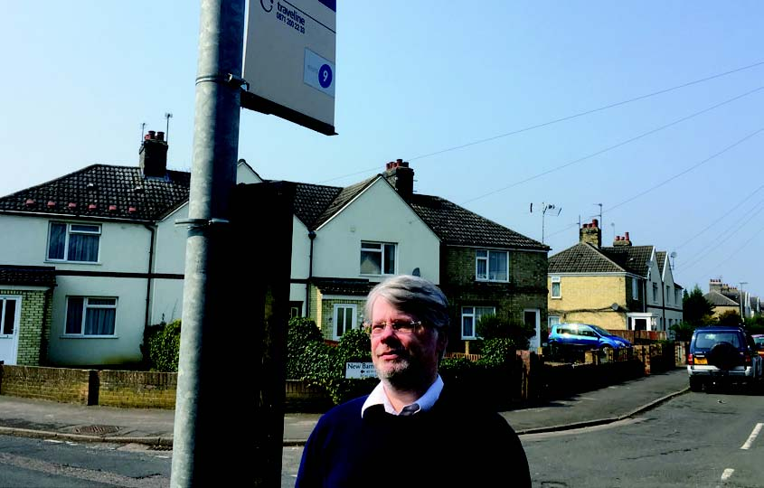 Kevin Wilkins at bus stop looking for our missing buses