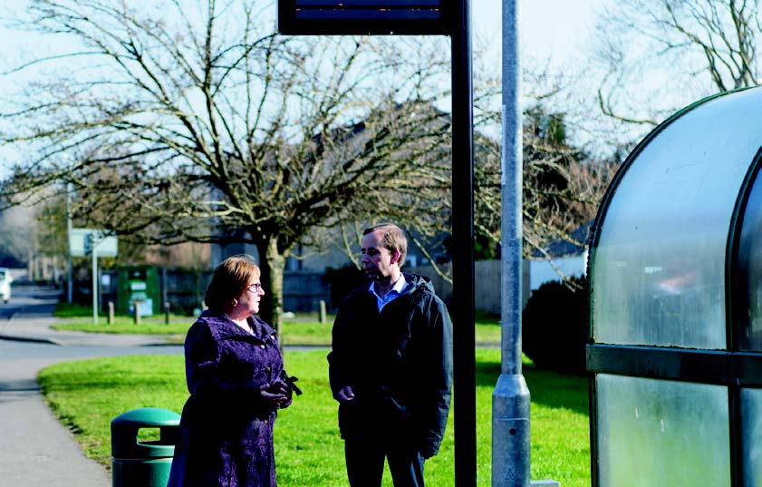 Lorna Dupre and Mark Inskip at a bus stop looking for missing buses