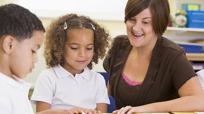 Qualified teacher with children