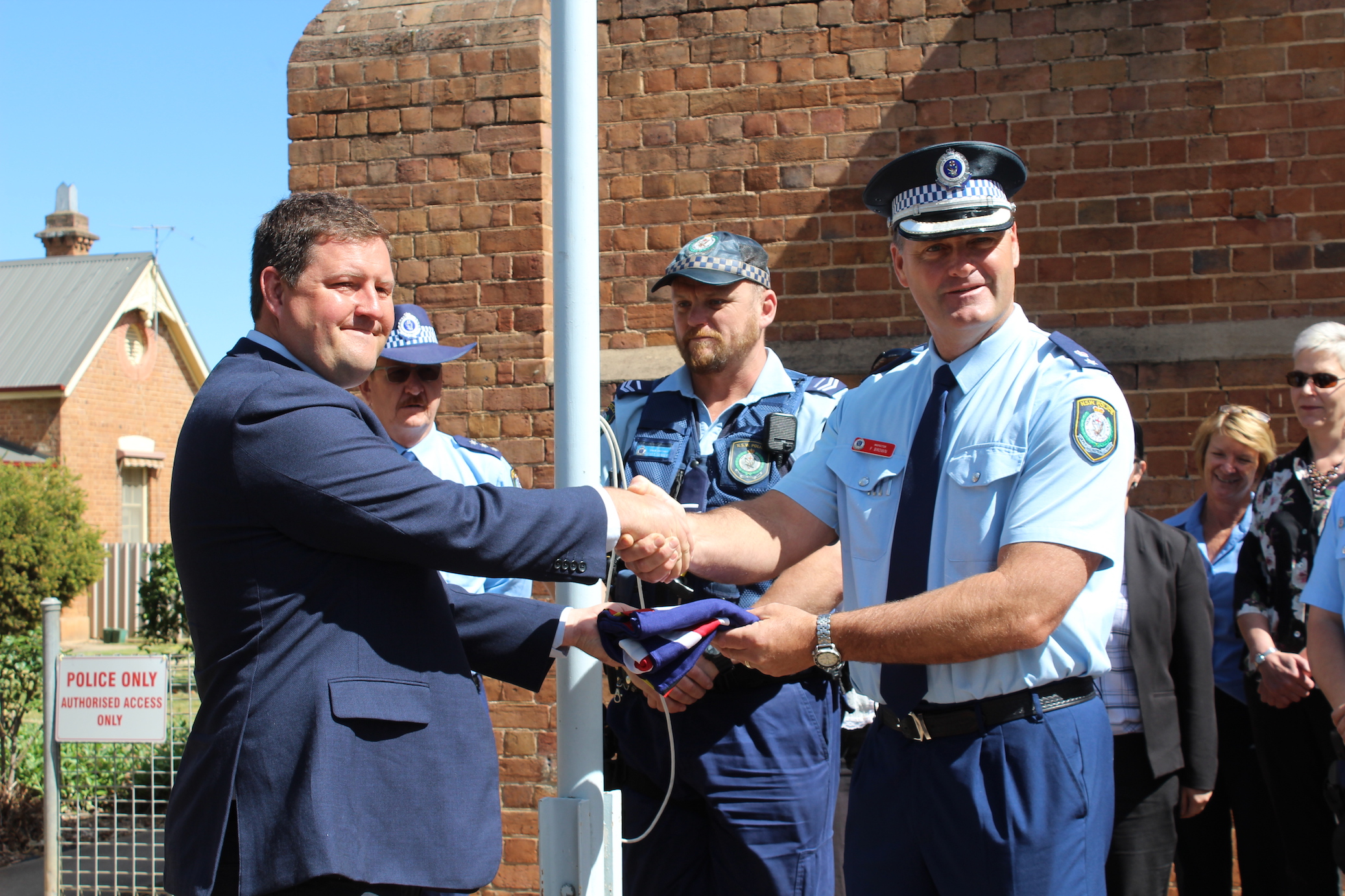Matthew Stadtmiller presenting Cootamundra LAC with a new flag.