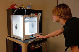 Teen with 3D Printer