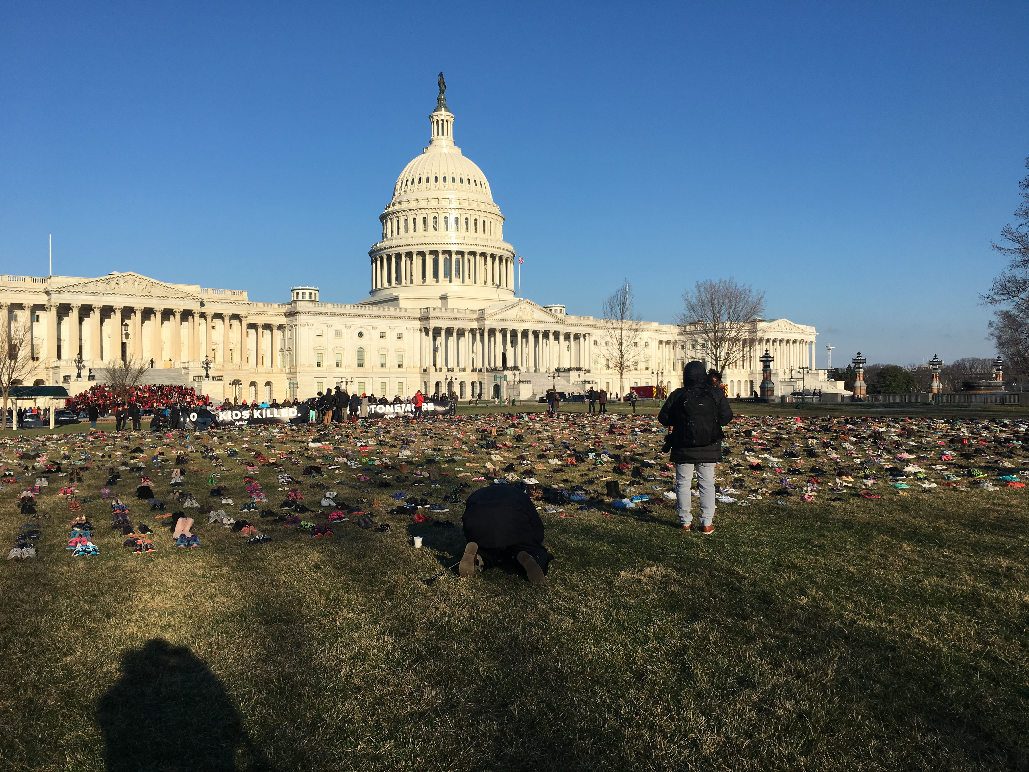 7000 pairs of children's shoes at the US Capitol, 3/13/2018, in a display organized by the international advocacy organization Avaaz