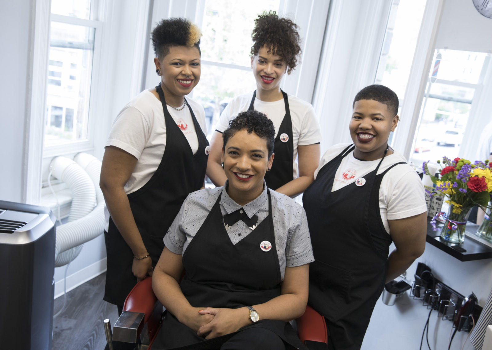 Lady Clipper barbers: Lesley Bryant in front. In back, Gabby Smith, left, Daisy Robinson, middle, and Jo Woodard, right. Photo credit: Tyrone Turner / DCist