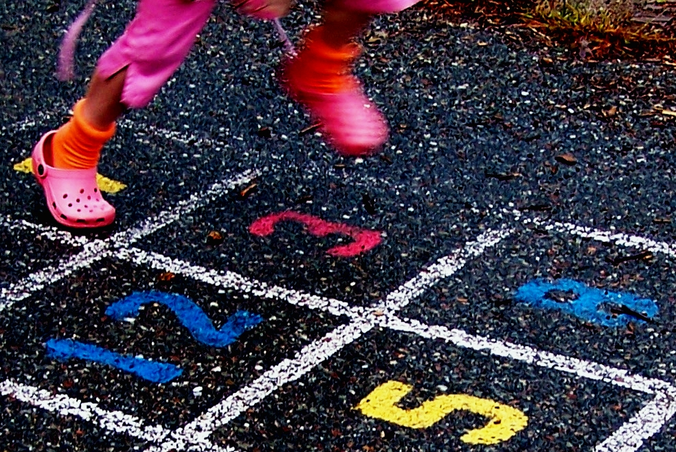 Child_jumping_hopscotch_in_crocs.jpg