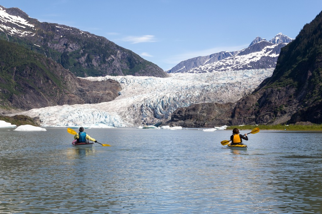 Co-worker Mary Wood and I got to take the Trak Kayaks out on Mendenhall lake when we were in Juneau this weekend. Later, we explored the ice caves on the side of the glacier. Unlike difficult to access arctic glaciers, Mendenhall is just outside of Juneau. Thousands of visitors every year come to see it, and are able to see how it is receding. Folks who grew up in southeast remember that it used to jut out all the way to the parking lot at the Visitor's Center not so long ago.