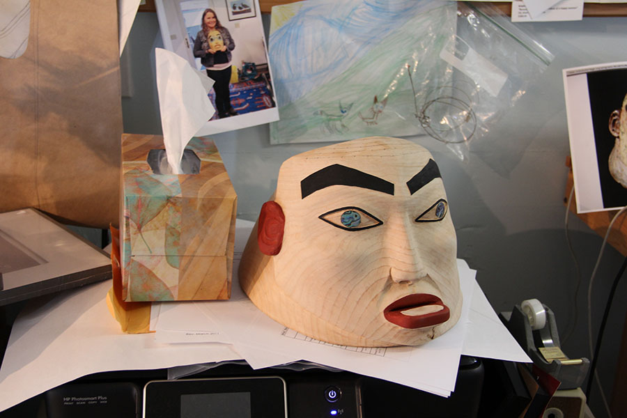 """I'm in love with the human face and the human experience,"" Kristina said of her work in Tommy's shop.  Despite a terrible injury early in her carving practices, she now has an apprenticeship where she is learning to make masks."