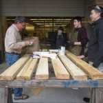 After treating the wood, the planks will dry out before being held together with steel nails resistant to rust. By taking these initial steps, the bike shelter will be able to better withstand the temperment of Southeast Alaska's weather.