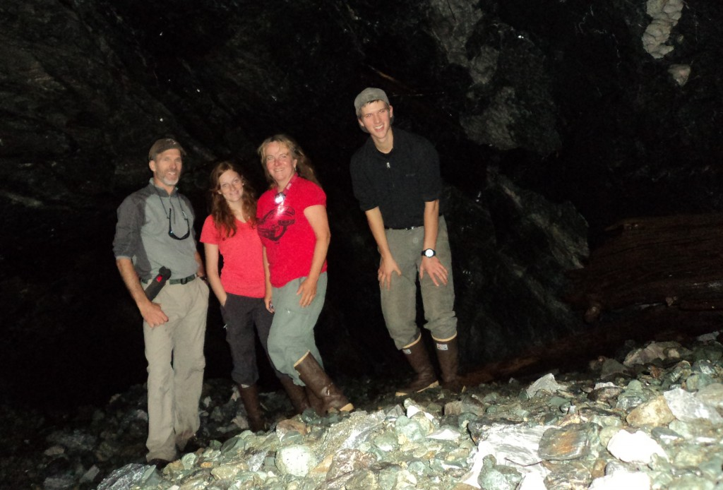 Self-timer group photo in a large cave found at Rust Lake