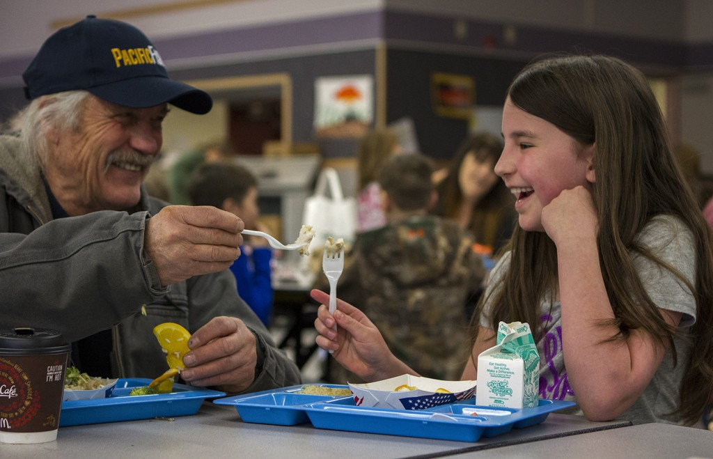 SCS Board Member Spencer Severson shares a Fish to Schools meal with a student at Keet Gooshi Heen Elementary School.