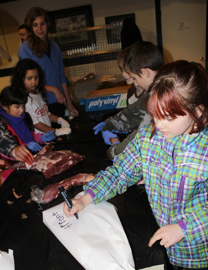 Participants pack and label venison for storage