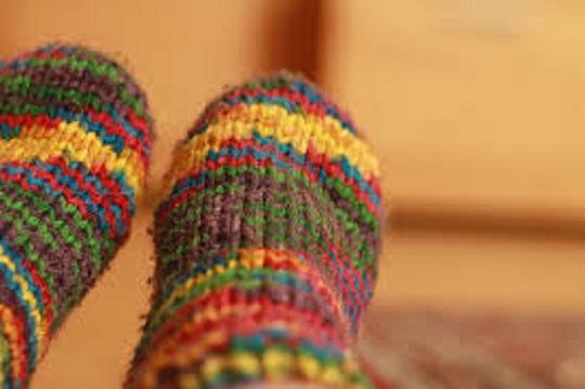 Feet wearing warm cosy socks.
