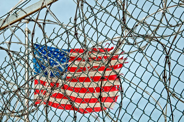 flag_in_barbed_wire.jpg