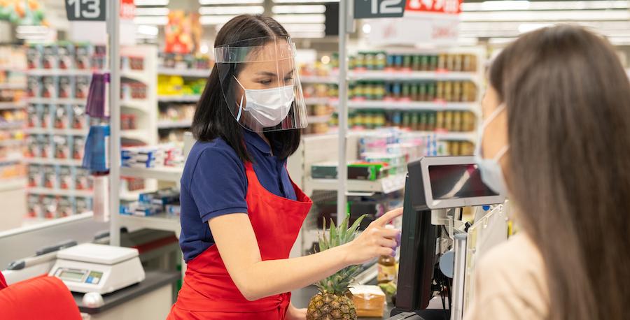 cashier-customer-wearing-personal-protective-masks-modern-supermarket-during-quarantine-days.jpg