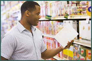 man reading nutrition label