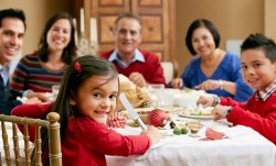 multicultural family at festive dinner table