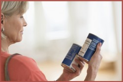 woman reading sodium level on food nutrition labels
