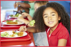 young girl eating school lunch