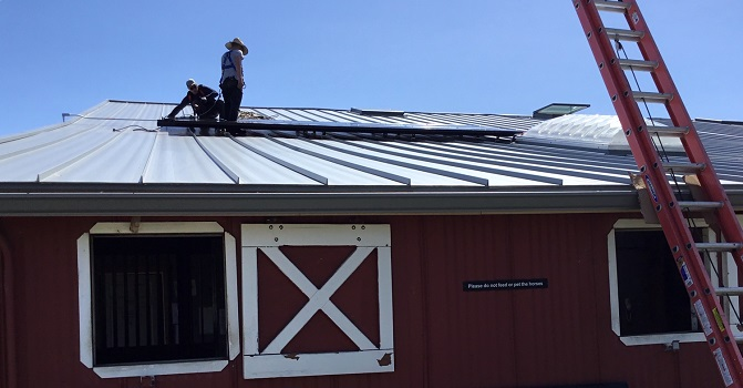 little_bit_2_workers_on_roof-use.jpg