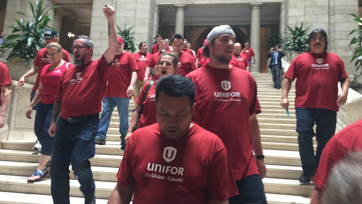 Unifor union members protest Bill 7 in the Manitoba Legislature.