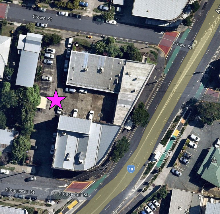 A satellite image of the Gabba Ward Office with a pink star indicating the meeting point at the centre of carpark